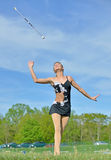 Beautiful blonde female twirler or majorette performs Stock Image