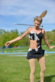 Beautiful blonde female twirler or majorette performs Stock Photography