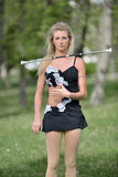Beautiful blonde female twirler or majorette performs Royalty Free Stock Photography