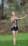 Beautiful blonde female twirler or majorette performs Stock Images