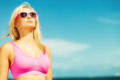 Beautiful blonde fitness girl on beach Royalty Free Stock Photos