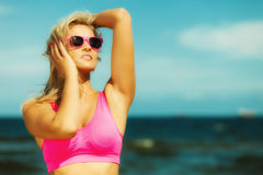 Beautiful blonde fitness girl on beach Royalty Free Stock Photo