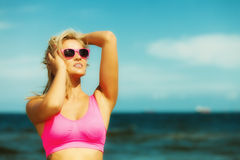 Beautiful blonde fitness girl on beach Royalty Free Stock Image