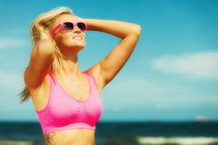 Beautiful blonde fitness girl on beach Royalty Free Stock Photography