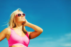 Beautiful blonde fitness girl on beach Stock Images