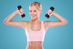 Beautiful blonde fitness model Stock Photography