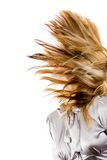 Beautiful blonde flipping hair. Beautiful blonde woman flipping her hair, isolated on white background Stock Images