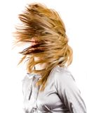 Beautiful blonde flipping hair. Beautiful blonde woman flipping her hair, isolated on black background Stock Photos