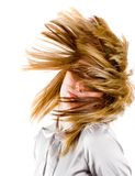 Beautiful blonde flipping hair. Beautiful blonde woman flipping her hair, isolated on black background Stock Images