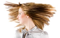 Beautiful blonde flipping hair. Beautiful blonde woman flipping her hair, isolated on black background Stock Photo
