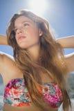 Beautiful blonde in floral bikini on the beach Stock Photos