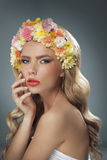 Beautiful blonde with the flower crown. Beautiful blonde with the colorful flower crown stock photos