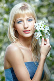 Beautiful blonde with flowers Royalty Free Stock Images