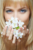 Beautiful blonde with flowers Stock Photo