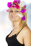 Beautiful blonde with flowers in her hair. Close up photo Royalty Free Stock Images