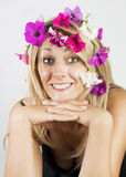 Beautiful blonde with flowers in her hair Stock Image