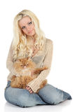 Beautiful blonde with a fluffy Persian cat Royalty Free Stock Images