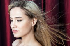 Beautiful blonde with flying hair Royalty Free Stock Image