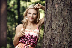 Beautiful blonde in a forest Royalty Free Stock Image