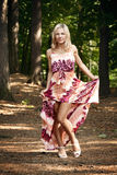 Beautiful blonde in a forest Stock Photo