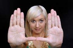 Beautiful Blonde Frames Her Face with Her Hands Royalty Free Stock Photo
