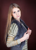 Beautiful blonde in a fur vest Royalty Free Stock Photography