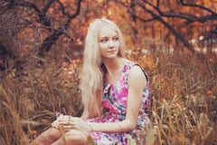 Beautiful blonde  in the garden Royalty Free Stock Image