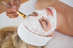 Beautiful blonde getting a facial treatment Stock Photo