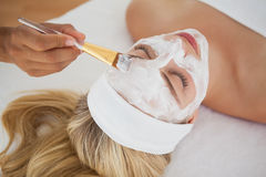 Beautiful blonde getting a facial treatment Stock Images