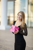 Beautiful blonde with a gift for a loved one Royalty Free Stock Photo