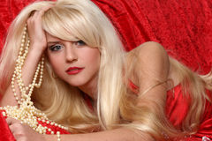 Beautiful blonde girl. Portrait on red background royalty free stock images