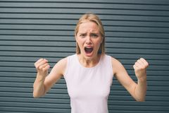 Beautiful blonde girl on the background , angry screaming woman, headache. Beautiful blonde girl on the background , angry screaming woman, headache Royalty Free Stock Images