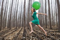 Beautiful blonde girl with balloon in the woods Stock Image