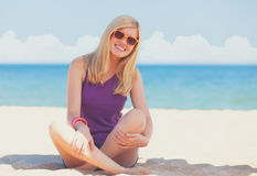 Beautiful blonde girl. At the beach royalty free stock images