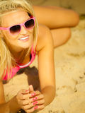 Beautiful blonde girl on beach, summertime Stock Photos