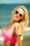 Beautiful blonde girl on beach, summertime Royalty Free Stock Image