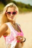 Beautiful blonde girl on beach, summertime Stock Image