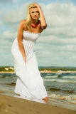 Beautiful blonde girl on beach, summertime Royalty Free Stock Photography