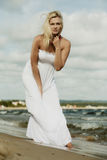 Beautiful blonde girl on beach, summertime Stock Images