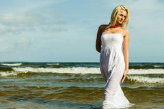Beautiful blonde girl on beach, summertime Royalty Free Stock Photo
