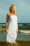Beautiful blonde girl on beach, summertime Stock Image