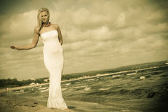 Beautiful blonde girl on beach, summertime Royalty Free Stock Photos