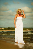 Beautiful blonde girl on beach, summertime Royalty Free Stock Images