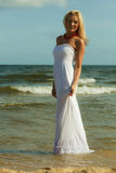 Beautiful blonde girl on beach, summertime Royalty Free Stock Image
