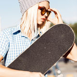 Beautiful blonde girl in beanie hat and leopard sunglasses with Stock Photography