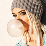 Beautiful blonde girl in beanie hat with smokey eye make up who Stock Photo
