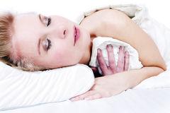 Beautiful blonde girl in bed. Royalty Free Stock Photography