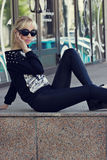 Beautiful blonde girl in black sunglasses Royalty Free Stock Photo