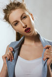 The beautiful blonde girl in a blue suit stock photos