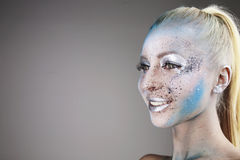 Beautiful blonde girl with bodyart on face isolated Royalty Free Stock Images